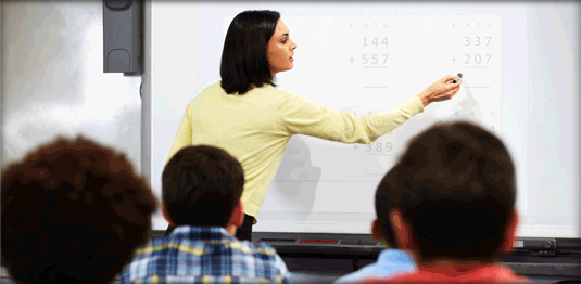 teacher-at-smart-board-math